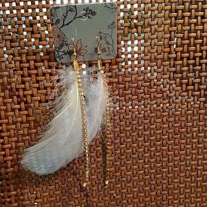 Powder blue feathers earrings